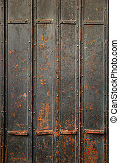 Black old metal door - Background of ancient black rusty...