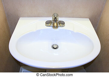 white sink and brushed nickel faucet in bathroom