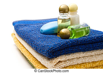Towels and shampoo bottles