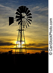 Wind Pump at sunrise with clouds