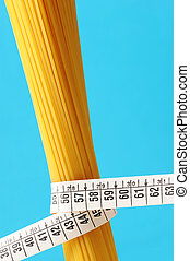 diet concept, Spaghetti with measuring tape