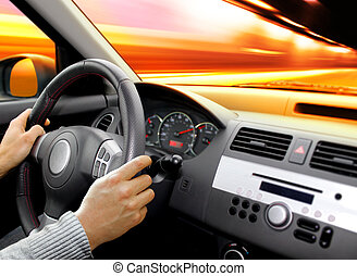 dashboard of car - hand of driver that holds wheel and goes...