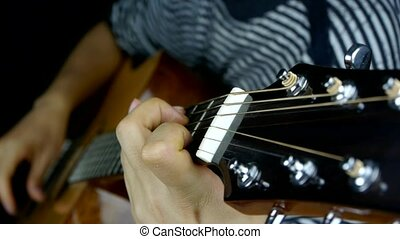 playing guitar,strum