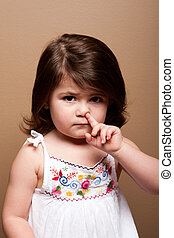 Toddler with finger in nose - Cute mischievous toddler girl...