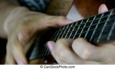 playing guitar,strum.