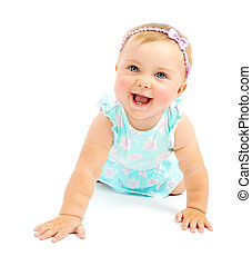 Adorable little baby girl laughing, creeping playing in the...