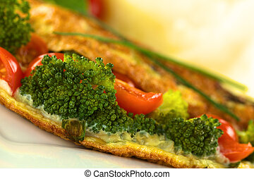 Broccoli and tomato omelette with mashed potato in the back...