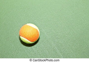 Tennis Ball with Copy Space - Single tennis ball on court,...