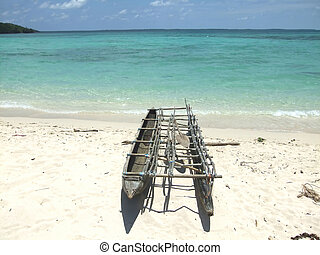 pirogue on a sandy beach, Papua , New Guinea