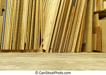 Sheets of Plywood in a Workshop - Sheets of various types of...