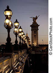Pont Alexandre III Bridge illuminated at night in Paris,...