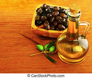 Olive Oil with fresh green & marinated black olives over...