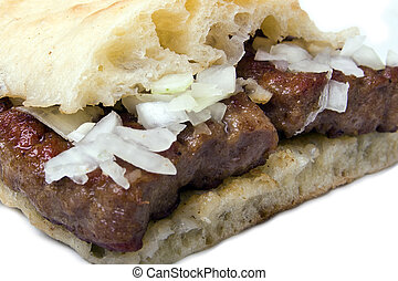 Kebab Cevap with onion - Delicious specialty made on grill...