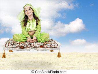 little arabian girl sitting on flying carpet