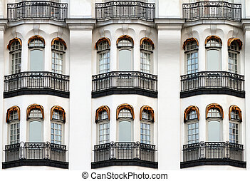 White vintage facade with balconies
