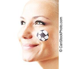 Closeup portrait of a happy football fan, shallow DOF,...
