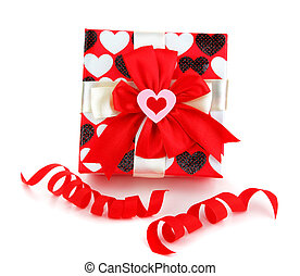 Red romantic gift box with heart isolated on white...