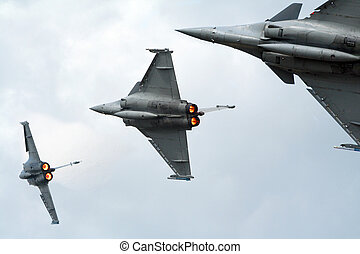 Fighter jets - Three grey fighters jets flyby with...
