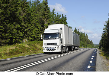 truck driving on scenic forest road - truck driving on a...