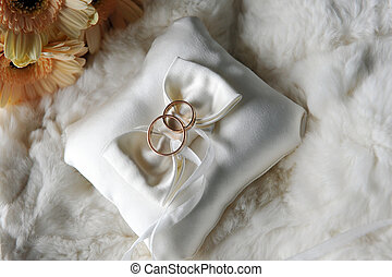 cushion with wedding rings - bride bouquet of yellow flowers...