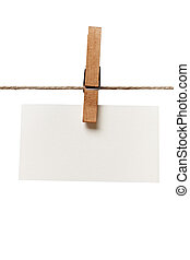 clothes peg and note paper on clothes line rope - close up...