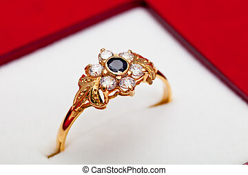 Gold ring with white and blue zirconia enchased - Fantastic...