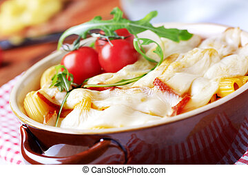 Pasta casserole - Macaroni topped with slices of smoked...