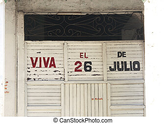 Cuban building with propaganda - Propaganda text on a...