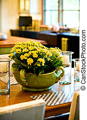 Fresh flower arrangement on the dining room table -...