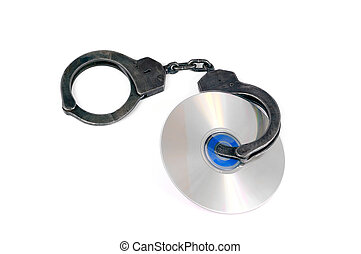 copyright - cd dvd in handcuffs fastened, isolated