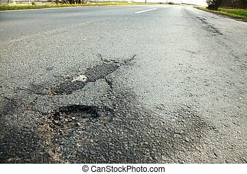 Pothole crack on the road surface