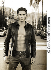 Sexy male fashion model - Sepia toned fashion portrait of an...