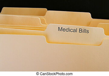 Folders with Medical Bills test, on black