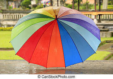 Rainbow umbrella - Open wet umbrella in the street