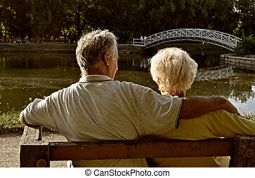 Retired couple relaxing - Senior couple relaxing, sitting on...