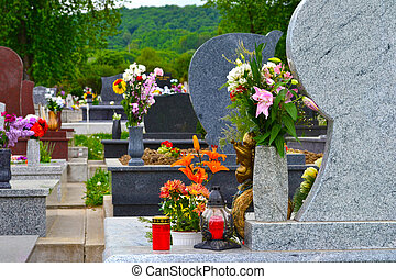 Cemetery with flowers - Tidied, well-kept cemetery with...