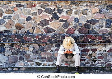 Pyramids of Teotihuacan - Mexican man has a siesta at the...
