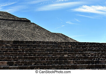 Pyramids of Teotihuacan with blue sky background