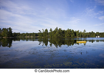 Calm lake water shot in Muskoka, Ontario Cottage Country