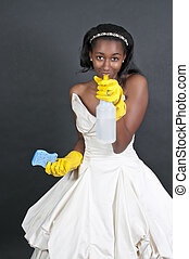 Woman Cleaning House - An African American glove wearing...