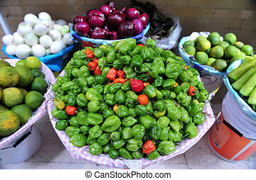 Mexican Market - An array of lemons, chillies and onions for...