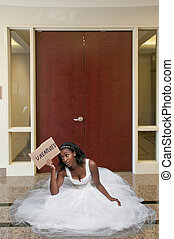 Unemployed Black woman in wedding dress