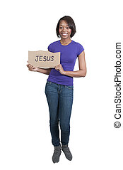 Woman Holding Jesus Sign - A beautiful young black woman...