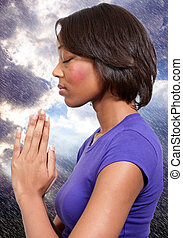 Woman praying - Beautiful Christian woman in deep prayer