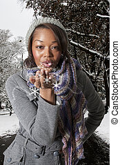 Woman Blowing a Kiss - A beautiful young woman blowing a...