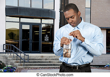 Retirement Account - A young man holding a jar of money...