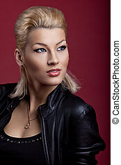 Beauty singer in black leather on red portrait - Beauty...