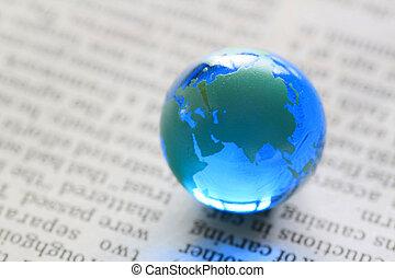 earth on  newspaper
