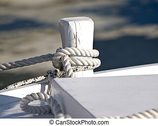 ropes on the boat docked in the harbour