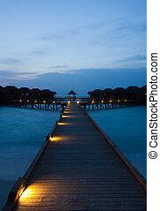 Water bungalows - Maldivian water bungalows at night